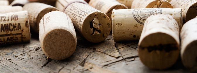 wine corks scattered on wooden surface